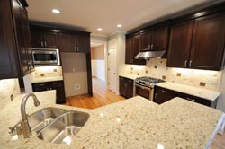 Light granite dark cabinets