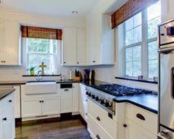 White cabinets Dark Granite